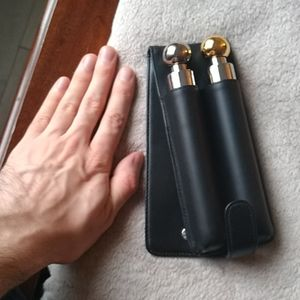 Twin flasks in black leather belt pouch